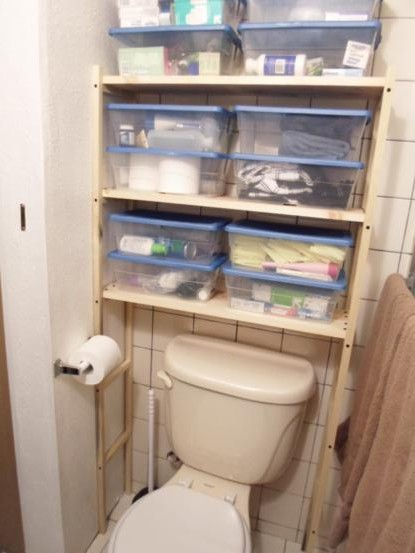 Diy over the toilet shelving unit one house one couple for Bathroom over the toilet shelf